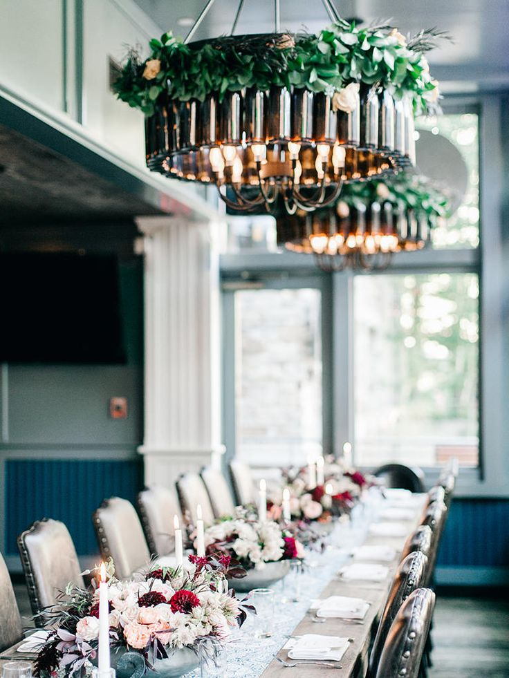 Chandelier decor is just the thing to tie together themed wedding centerpieces. Complement the twinkle of taper candles with overhead lighting to set a rustic mood to the wedding reception.