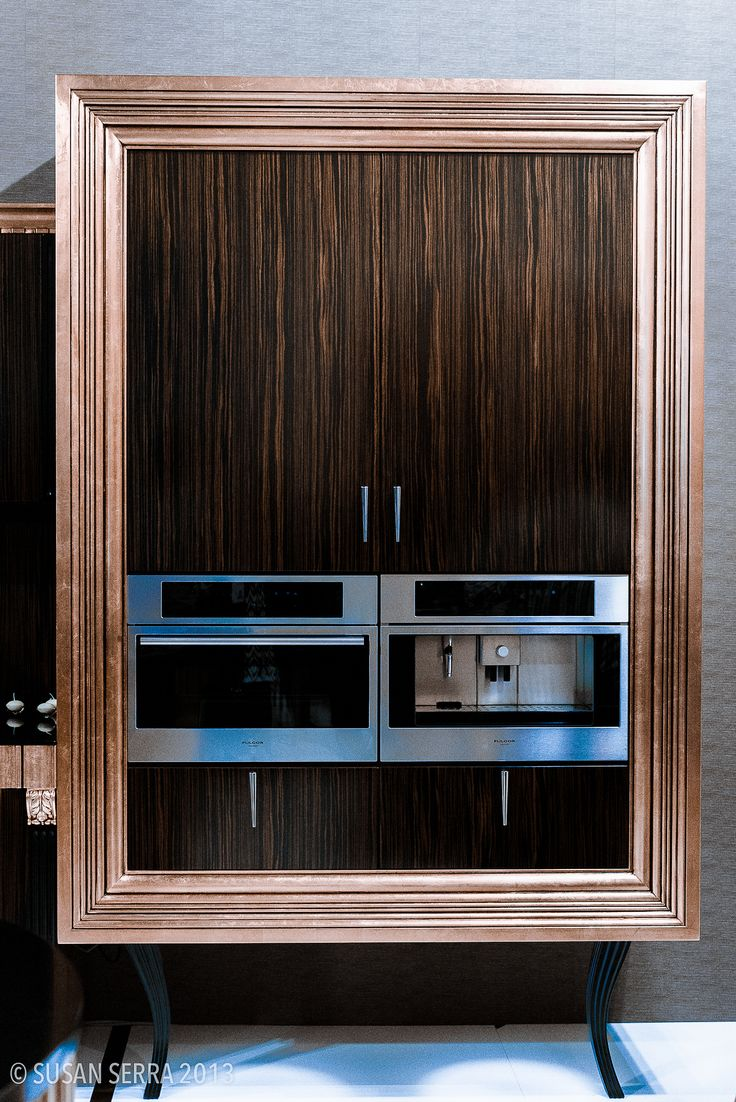 custom designed and built appliance and pantry storage with a mix of exotic wood finishes for a luxury kitchen milan