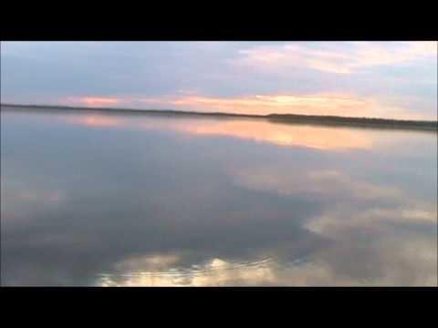 Paddling in the midnight sun at Unijoki river, Posio Lapland