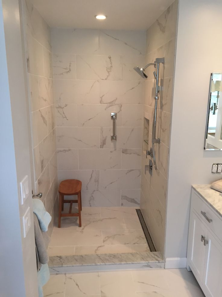 Custom shower stall Linear drain Calcutta porcelain tile
