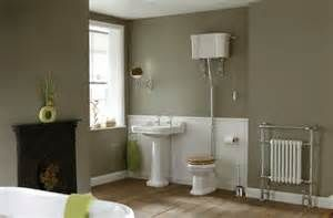 I like the white panelling and a darker wall colour - may be harder with tiles walls.