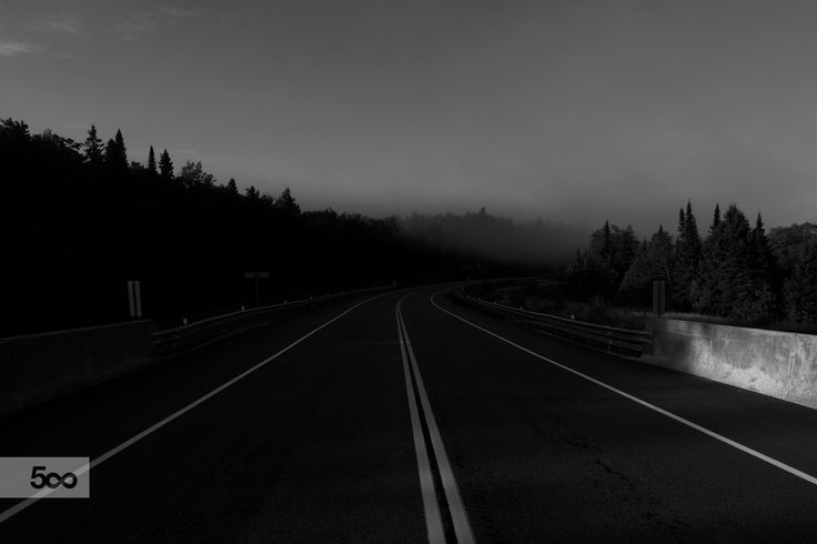 Walking on the road through Algonquin provincial park. Taken in the early morning