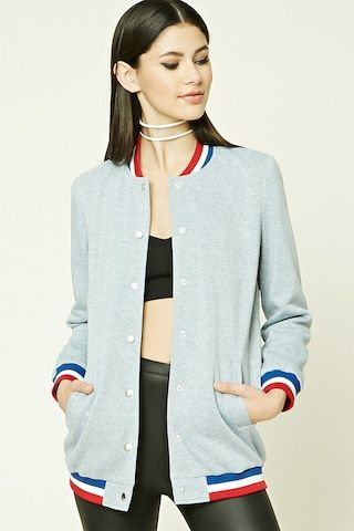 A heathered knit varsity jacket featuring a longline silhouette, contrast striped trim, a snap-buttoned front, long sleeves, and front slip pockets.