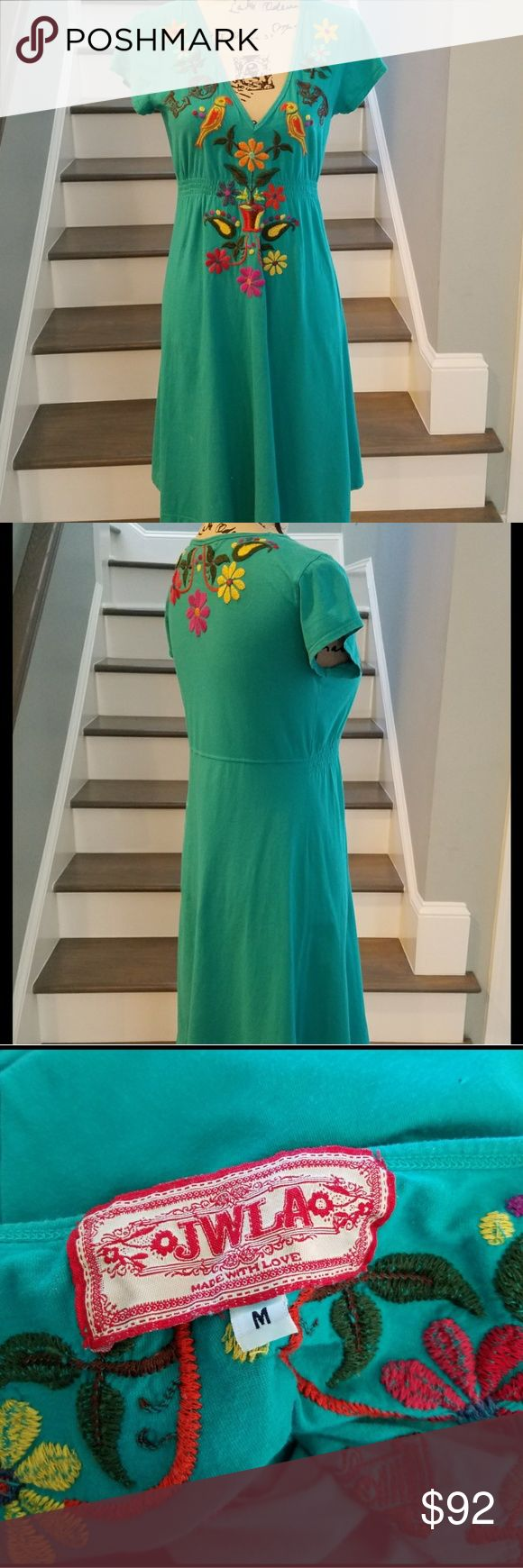 """Johnny Was(LA) pullover tunic/dress Beautiful teal colored dress with multicolored embroidered flowers and birds. 100% cotton. Measured lying flat. Middle of back neckline to hem 37"""". Armpit to armpit 17.5-18"""". Waist 15"""". Elastic under empire waist. V neck. Small cap sleeves. Mint condition. Smoke free/pet free home. No trades. I only deal through Poshmark. Johnny Was  (JWLA) Dresses"""