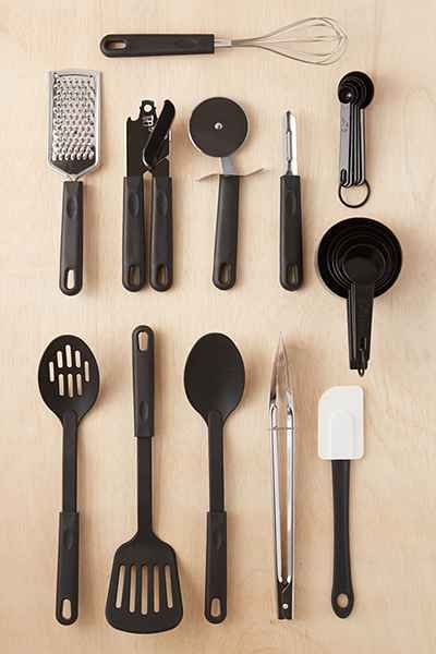 Total Kitchen 20-Piece Utensil Set - Urban Outfitters - Includes: peeler, pizza cutter, can opener, whisk, grater, tongs, solid turner, spoon, slotted spoon, spatula, 5 pc measuring cups, 5 pc measuring spoons