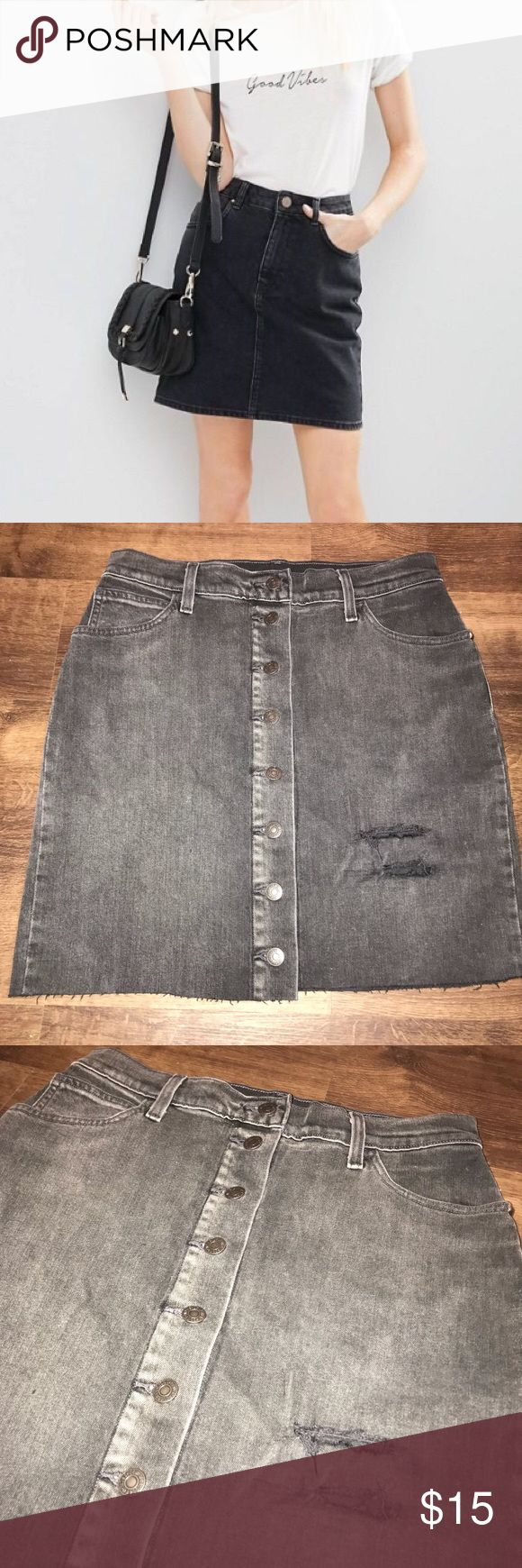 Levi's Vintage Everyday Distressed Denim Skirt Levi's Grey Distressed Denim Skirt Size 28 Length measures @ 18.5 inches  Button up front  Stretchy & comfortable  99% cotton  **model picture is not the item for sale, just a similar look Levi's Skirts Mini