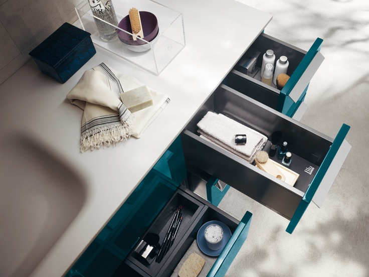 """Aquo Collection. The solutions of this composition with glossy lacquered Baltic Blue doors benefits from the ample range of accessories and space-organizers for storing away the things we use every day. Cristalplant top, with 60 cm integrated """"Feature"""" #washbasin . The #bathroom according to Scavolini. #BluScavolini."""
