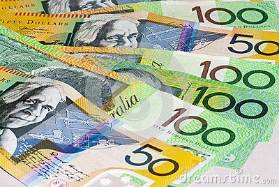 Australian Fifty and One Hundred Dollar bills Fanned on a flat surface. Copyspace.