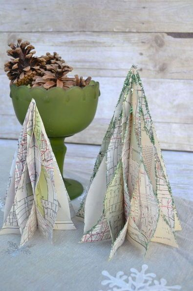 Paper Christmas trees made from vintage maps with glittered edges.