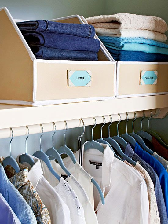 """Shelves are a prime place to stack sweaters and jeans, but without a little support, the stacks can become haphazard. Prevent the jumble with high-sided, low front bins like these from Great Useful Stuff. """"If you need something from the bottom of the stack, just pull down the Velcro front,"""" Smallin Kuper says./"""