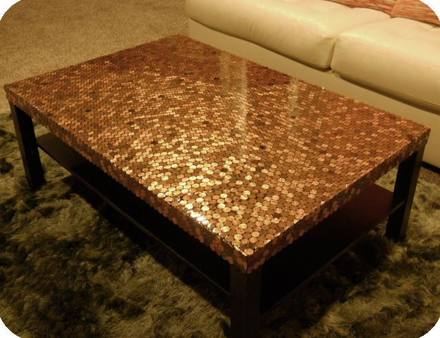 Penny covered coffee table.  Unique and stunning.  Also, on this site, penny covered floor.  Totally awesome.