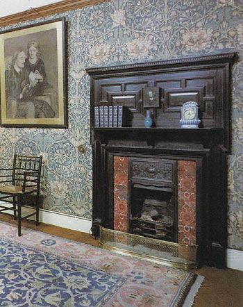 "William Morris fireplace -- once I was so distracted by the ""William Morris"" room in a period movie that I missed all of the dialogue, but I can tell you about the willow wallpaper and wonderful fireplace.  I wonder where this room is located..."