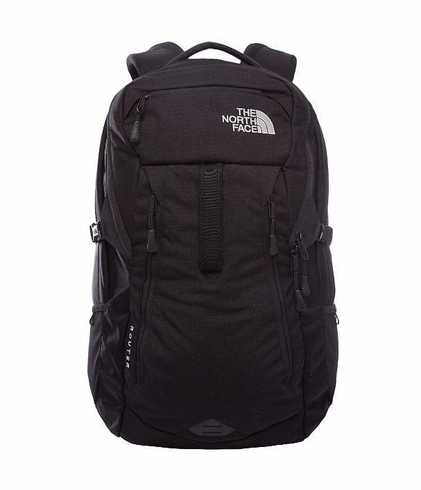 """The North Face Router Carry everything you need for an action-packed day in our largest backpack, the redesigned 35-liter Router that's constructed of hyper-durable ballistics nylon and crafted with a padded haul handle on the exterior. Features a front organizational compartment, a larger main compartment, and a 17"""" laptop compartment that zips completely open and lays flat to meet TSA requirements. Fleece-lined pockets include a tablet sleeve, media pocket and a sunglass pocket."""