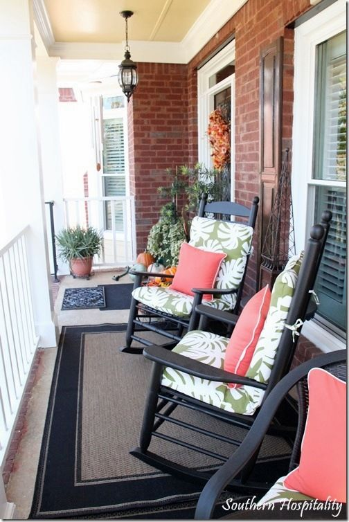 love this mix of summery fall porch decor w brick.