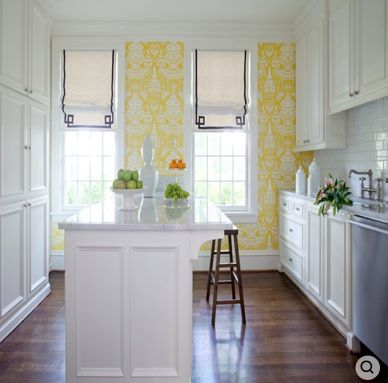 yellow wallpaper | roman shades with gray ribbon trim in a greek key pattern | lovely white island with barstools