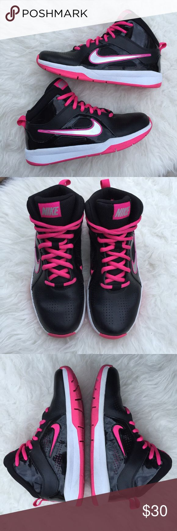 Youth nike black pink hightop. Black pink nikes. Excellent used condition youth size 5 black and pink high top nikes. Very little wear. Some scratches on the Nike emblem as photographed. Please review photos for details and wear. No trades. Youth size 5 can also fit women's size 6.5 according to their size chart. Nike Shoes Sneakers