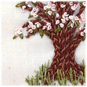 Nice embroidered tree!! Love it!  The site says it's chain stitch - but it's either closely variegated yarn, or two different needles.