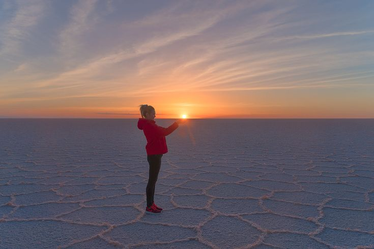 Discover amazing travel photos around the world. Pictures that inspire wanderlust. Daily Travel Photo - Sunrise at the Salar de Uyuni in Bolivia