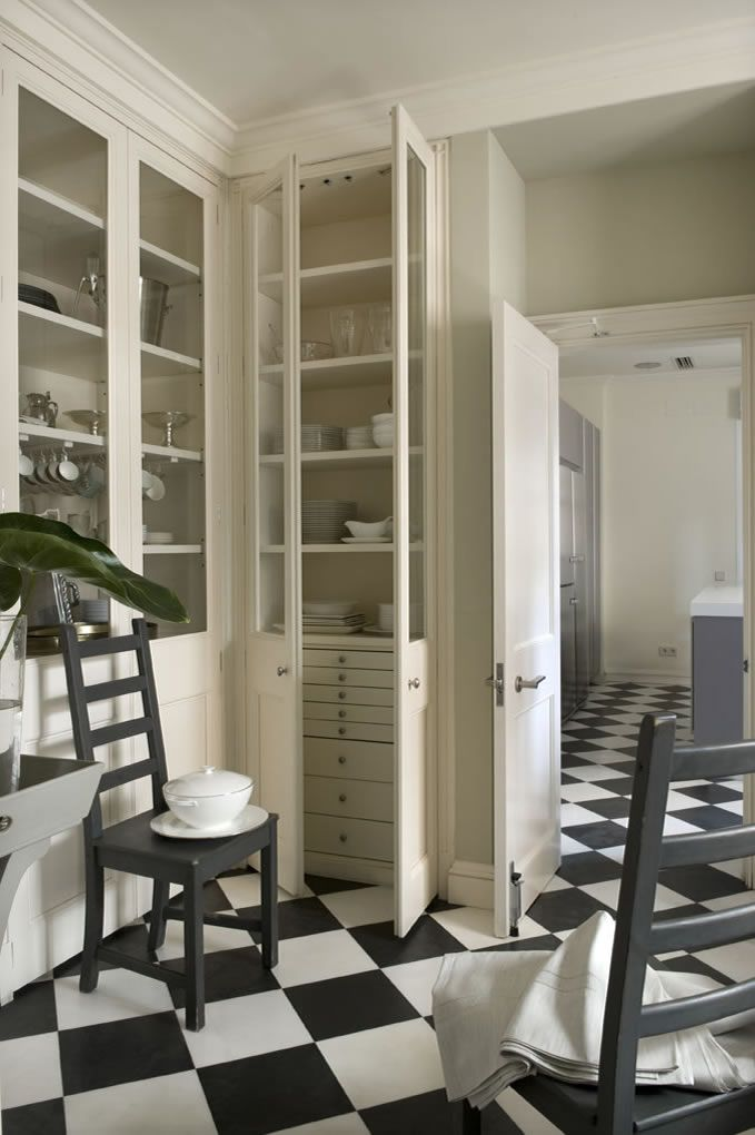 Viso, Madrid, by interior designer LORENZO  CASTILLO - see smaller drawers hdden inside larger cabinet doors
