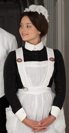 Picture perfect maid wearing an Edwardian-era uniform.