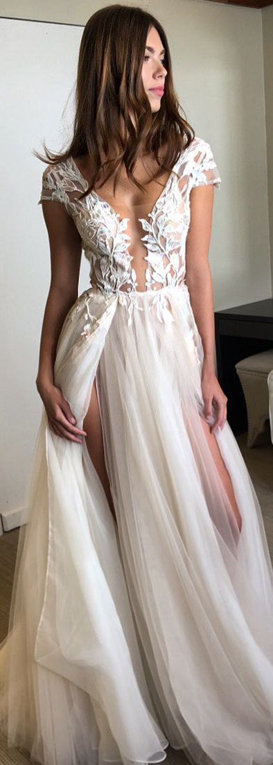 Love the illusion neckline on this MUSE by @bertabridal wedding dress - and as for those thigh high splits? Swoon!