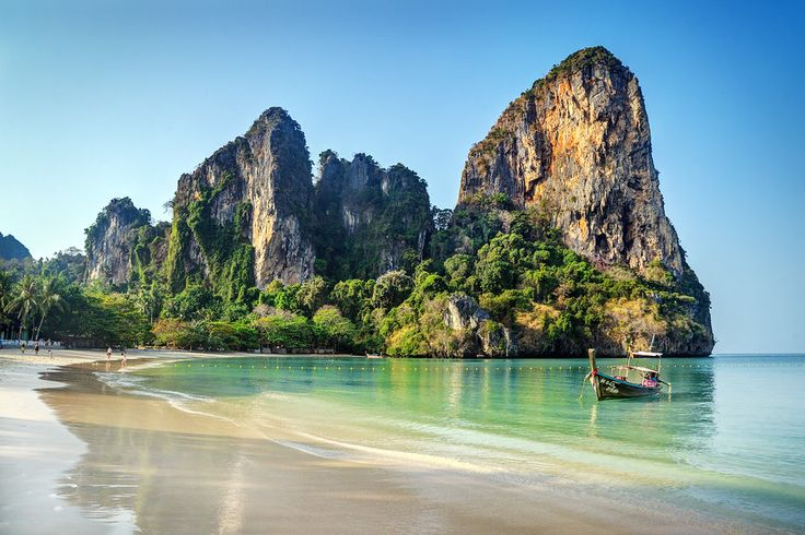 Giant pillars of karst limestone protrude into the sky around Railay Beach, home to some of the best rock climbing in the world. Learn more: http://expertvagabond.com/rock-climbing-railay/