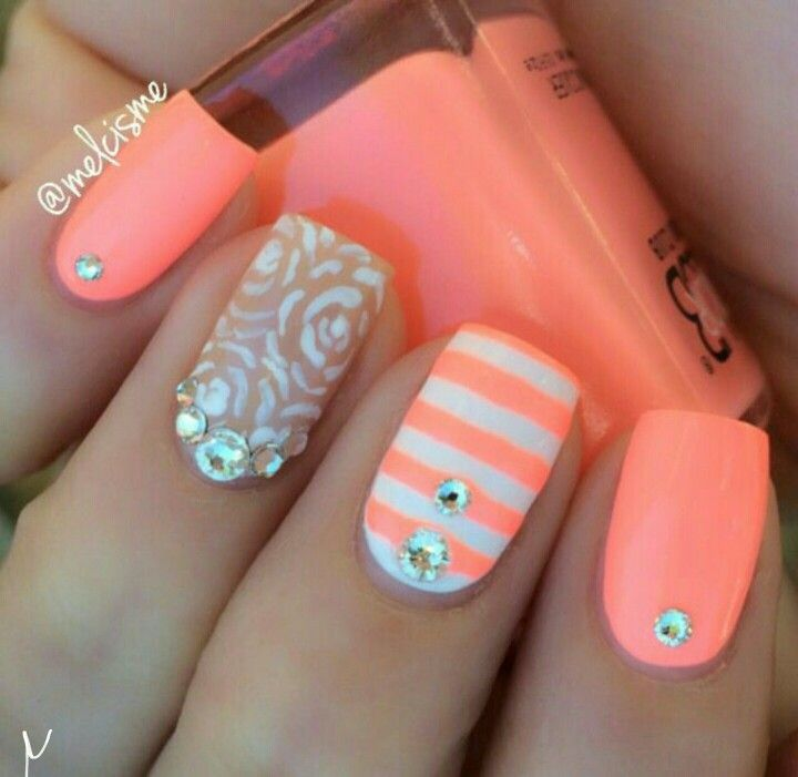 Love the colors in this nail art, perfect for spring & summer. Stripes, rhinestones & flowers.