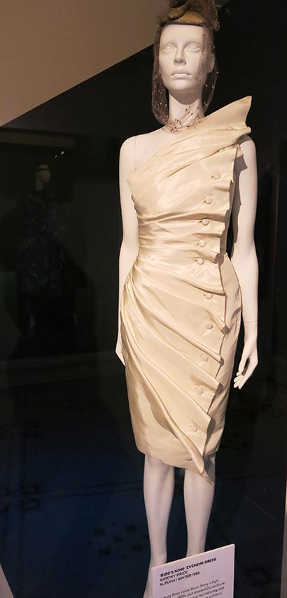 Antony-Price:(Birds-Wing-dress) Very structured and simplistic cream with bird wing outline decorated with buttons