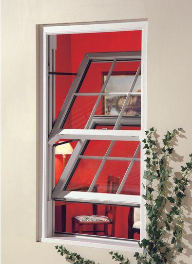 This uPVC sliding sash window with Cottage bars looks great