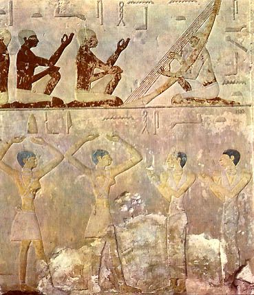 A harpist playing harp and two cheironomists.  Tomb of Ny-kheft-Ka. V Dynasty, 2498-2345 BC, Old Kingdom.  Bas-relief, detail. Stucco and limestone.  Necropolis at Saqqara.  The Egyptian Museum, Cairo.