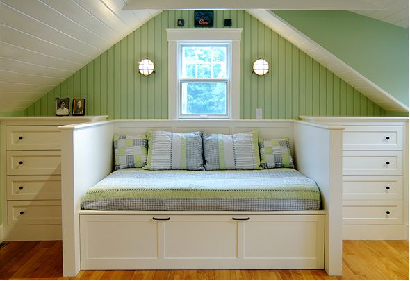 Built in dressers and day bed under eaves.