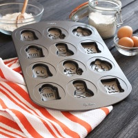 Wilton Halloween Cookie Press Pan - I would love to have this- and the Halloween Finger Cookie Pan and the Wilton Halloween Coffin Cake Pan