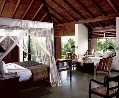 Colonial style traditional bedroom, dark woods, mix of hard and soft furniture