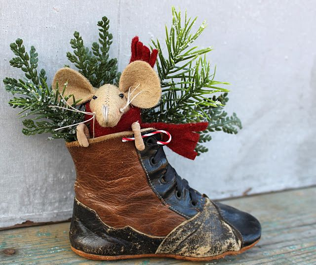 Fun idea - use an old boot for Christmas deco. Door stop or out door centre piece.