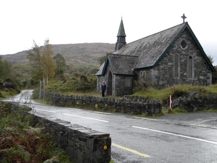 Irish stone church overlooking a lough, Co. Kerry