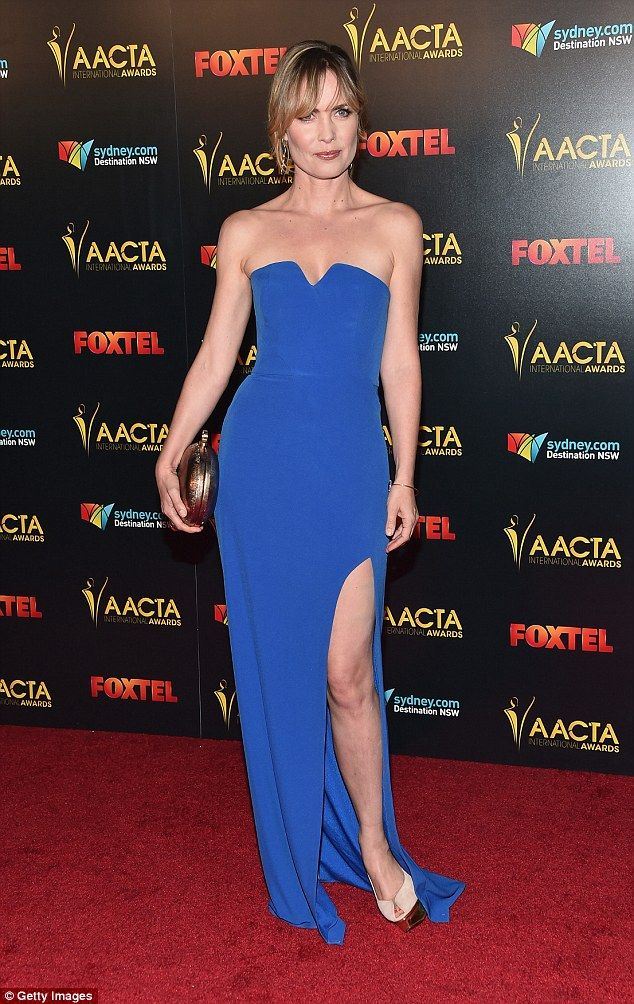 Stunning: Actress Radha Mitchell, 43, stunned in a streamlined lilac frock, which she accessorised with a metallic clutch, a thin gold bracelet and drop earrings