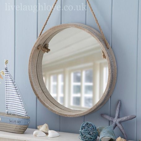 Porthole shaped shabby chic mirror. Wooden frame with a distressed washed effect and rope detail for hanging. #nautical #beach