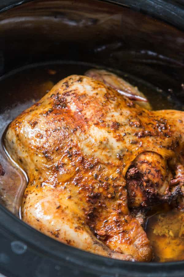 This is the easiest way to enjoy a juicy, rotisserie like chicken by only using a crockpot. Slow cooker whole chicken that anyone can make!