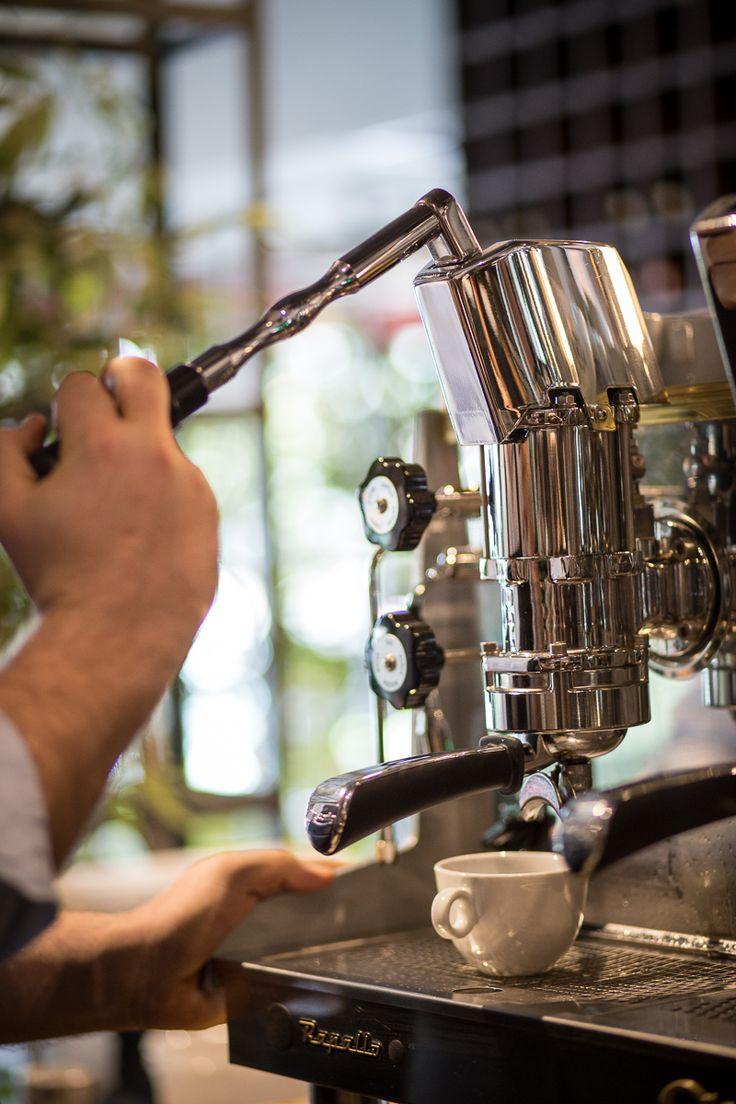 barista pulling a shot from lever espresso machine Astoria rapallo