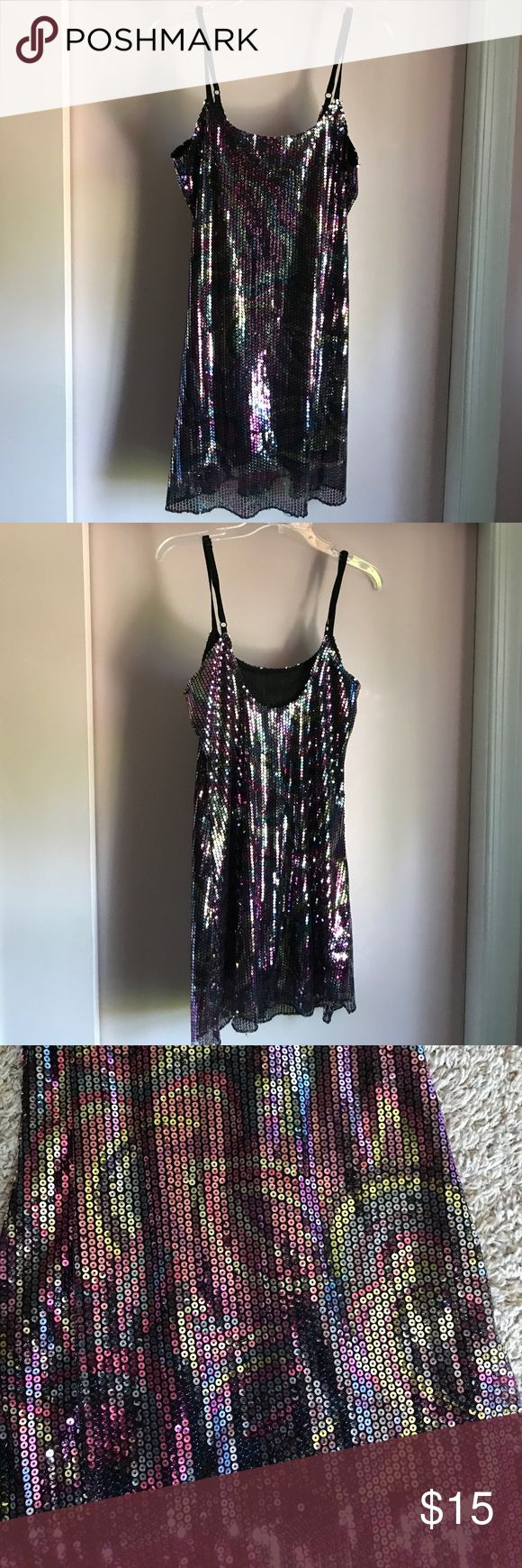 Multi colored sequenced tunic Lightly worn. No snags or tears. Very fun for New Years or a party. Can be worn as a mini dress depending on individuals height or worn with black leggings as a tunic. Wet Seal Dresses Mini