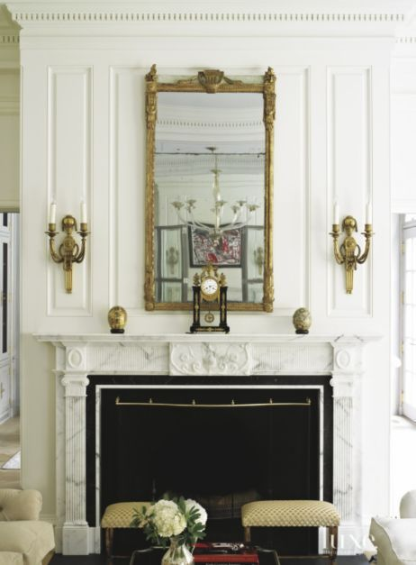 White Paneled French Inspired Fireplace