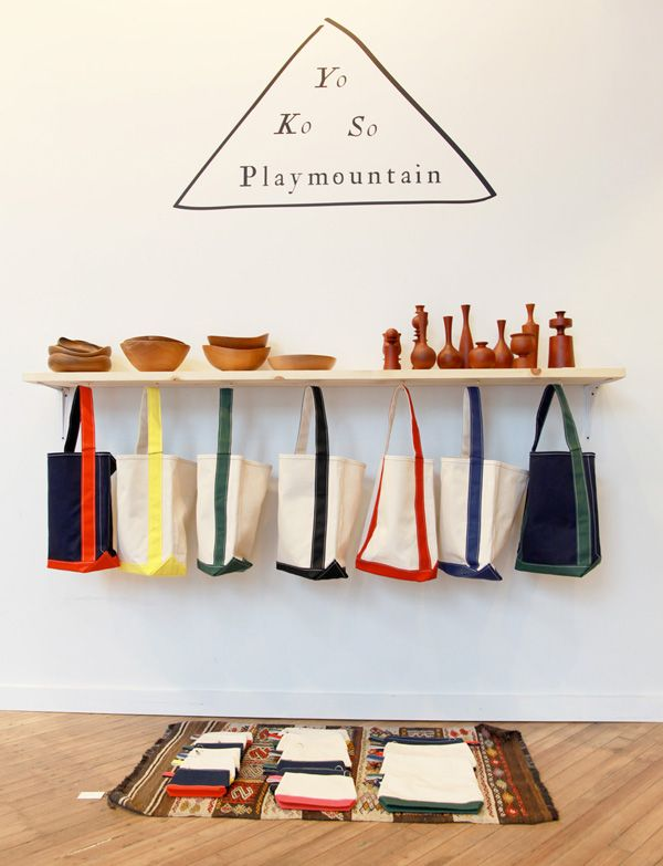 I love the idea of those bags for toy storage.  (playmountain, Tokyo is in Creatures of Comfort, NY)