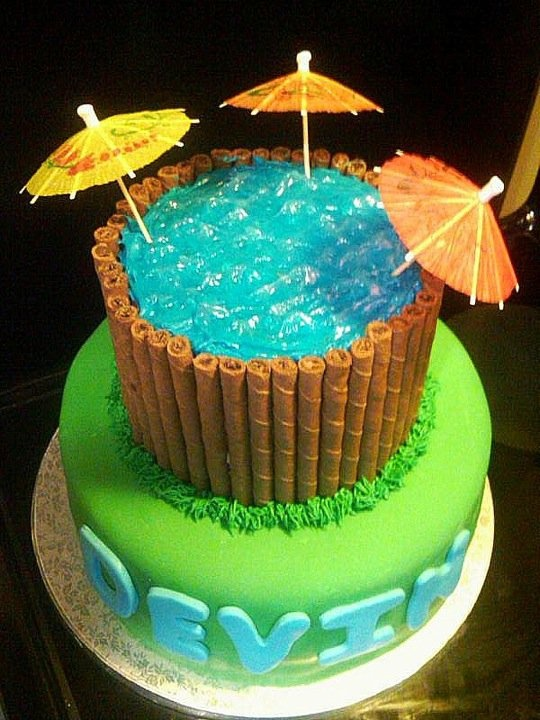 top view of pool party cake that sweet looking water was made from piping gel