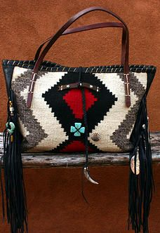 Brissa Tote Handbags made from Navajo blankets / rugs, vintage horse tack, and deer, elk or cowhide leathers. I embellish the bags with vintage trade beads, turquoise, coral, nickel silver/German silver Concho buttons, nickel silver spots/studs, and deer antler tips.   Ooo So Santa Fe Totes Santa Fe, NM
