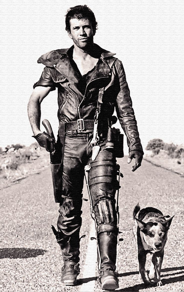 wanderer with gun and dog. badass.    mad max.Post-apocalyptic fashion inspiration for men.
