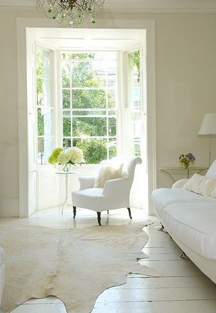 reading nook, open window space, all white, white cow hide, green hydrangeas