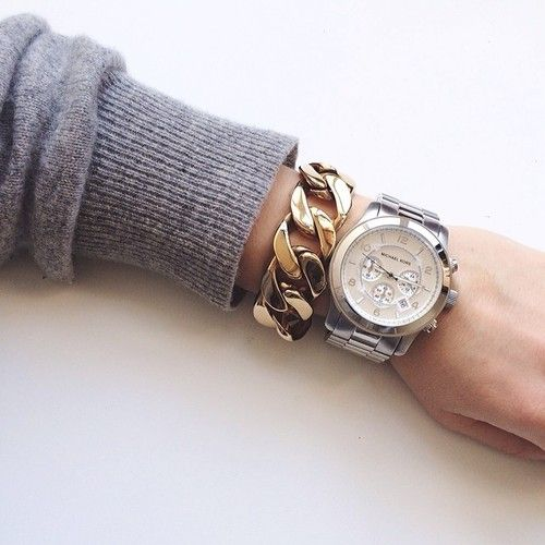 Grey sweater, chunky gold chain bracelet + big watch