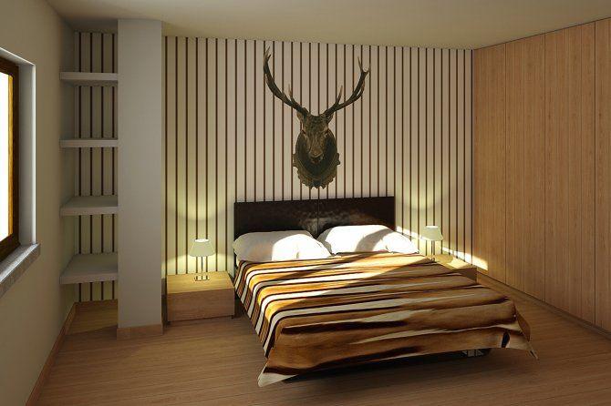 Appartamento a Foppolo - inetrior design - camera da letto con pareti a righe  -La camera da letto colpisce per la carta Wall&Decò usata, si è voluto giocare sul richiamo al passato degli animali imbalsamati a parete, caratteristici nelle abitazioni montane