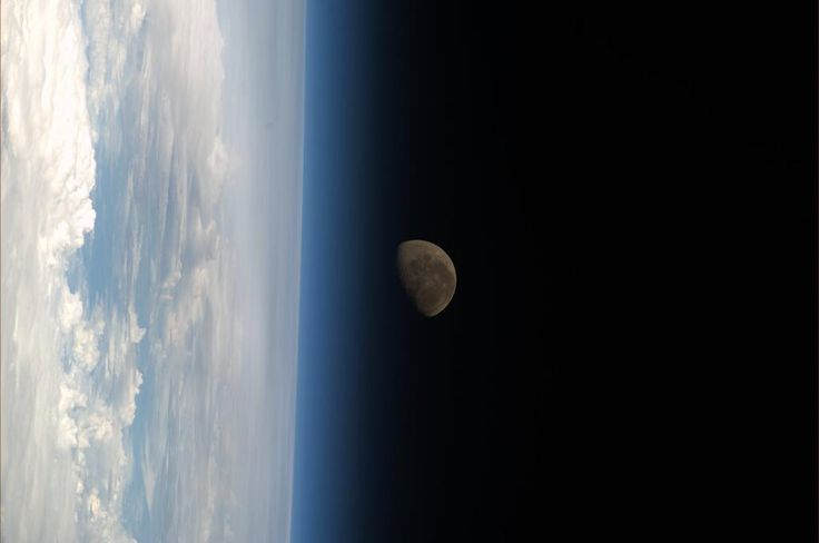 The moon setting with the Earth in the foreground.