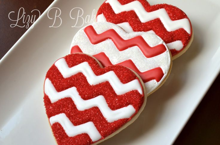 Valentine's Day decorated heart sugar cookies. Royal icing. Red, white. Chevron.